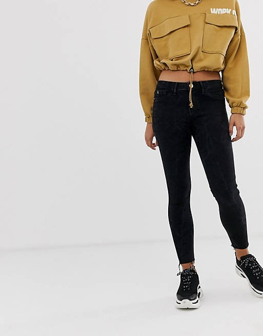 River Island Molly Skinny Jeans with Raw Hem in Washed Black_womens jeans on sale_revelle