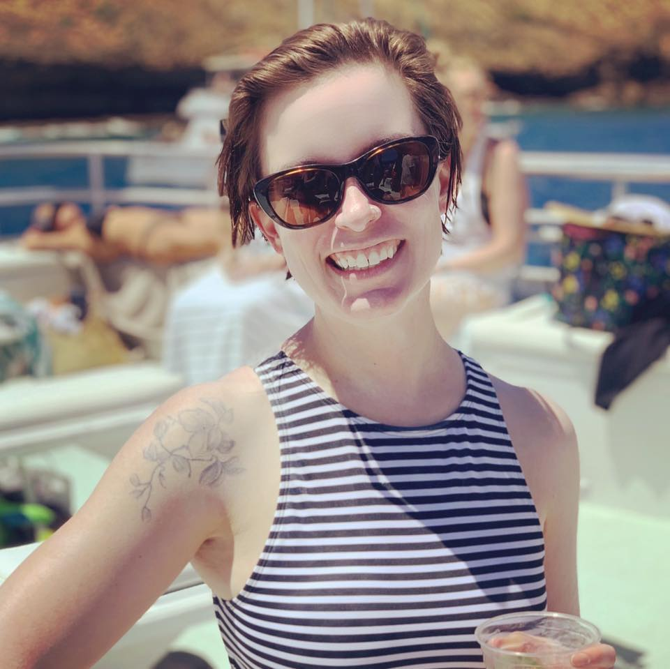 woman smiling with sunglasses on_brianne wilson_revelle